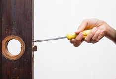Locksmith fix lock on wooden door Royalty Free Stock Photography