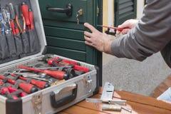 Locksmith repair the door lock. Locksmith repair a door lock replaces the lock and fixes the screws royalty free stock photos