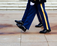 In lockstep. Two military honor guards marching in lockstep during changing of the guard ceremoney at Arlington National Cemetery, Virginia, just outside royalty free stock photography