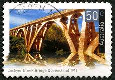 Lockyer Creek Bridge in Queensland Australian Postage Stamp. AUSTRALIA - CIRCA 2004: A used postage stamp from Australia, depicting an image of Lockyer creek royalty free stock images