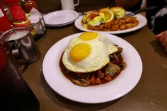 Loco Moco , traditional Hawaiian cuisine , burger patty on rice with a fried egg and brown gravy sauce. Image stock photo