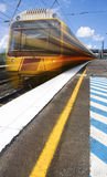 Loco Motion Train. A Moving Train Races Past A Stations Platform At Speed Royalty Free Stock Photos