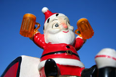 Loco Santa 13. Santa making a list and drinking it twice. Antique ceramic Santa Stock Photography