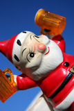 Loco Santa 15. Santa making a list and drinking it twice,antique ceramic santa, Christmas Stock Photo