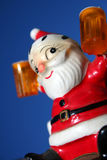 Loco Santa 18. Santa making a list and drinking it twice, antique ceramic santa, Christmas Stock Photo