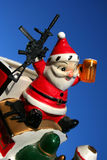 Loco Santa 19. Santa locked and loaded, antique ceramic santa, Christmas Royalty Free Stock Photography