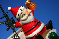 Loco Santa 20. Santa locked and loaded, antique ceramic santa, Christmas Stock Photos