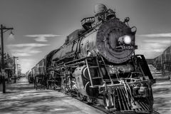 Locomotiva ardente de carvão cerca de 1930 referentes à cultura norte-americana Fotos de Stock
