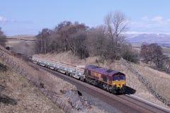 Comboio de mercadorias no acordo do túnel de Birkett a Carlisle Imagens de Stock