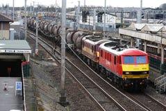 Locomotivas elétricas com o trem da pasta da argila de porcelana Fotografia de Stock
