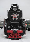 Locomotive. Old Soviet locomotive at a train station in winter,front view Stock Photos