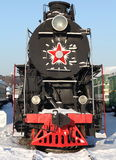 Locomotive. Fragment of the old Soviet locomotive at a train station in winter Royalty Free Stock Photos