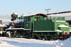 Locomotive. Old  locomotive at a train station in winter Royalty Free Stock Photos