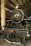 Old steam locomotive. An old steam locomotive in a warehouse Royalty Free Stock Image