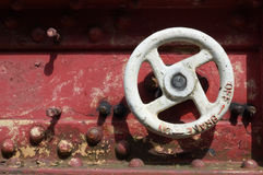 Locomotive brake wheel. On a red boxcar royalty free stock image