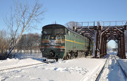 Locomotive on the bridge. The locomotive moves through zhleznodorozhny bridge Stock Photos
