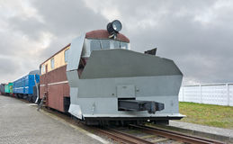 Locomotive. For clearing snow from train tracks is on a background of the cloudy sky Royalty Free Stock Photos