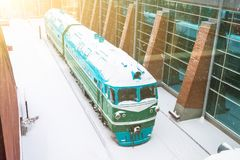 Locomotive covered with snow at the station in winter. Stock Photography