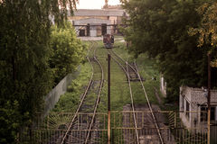 Locomotive depot. The locomotive is in the depot. Rails and greens around Royalty Free Stock Photo
