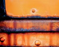 Locomotive design element refrigeration car aged and worn plates that exibit yellow and brillant orange hues. Royalty Free Stock Photo