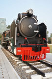 Locomotive is on display in the park at Siriraj Hospital. Black and red locomotive is on display in the park at Siriraj Hospital Bangkok Thailand Royalty Free Stock Photos