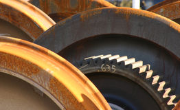 Locomotive Drive Wheels. Discarded locomotive drive wheels at a rail yard in Carrollton Texas showing drive gear and multiple disks Royalty Free Stock Photos