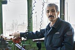 Locomotive driver. Caucasian locomotive driver at work. Horizontal shot Stock Photos