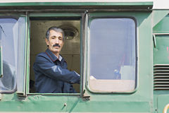 Locomotive engineer in the window Stock Photos