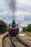 Locomotive enters the platform, an old steam train Royalty Free Stock Photography