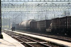 Locomotive with a freight train at a railway station stock photo