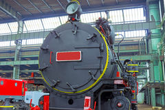 Locomotive. The front of the new locomotive in the factory,photography Royalty Free Stock Image