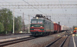The locomotive is going. The locomotive with cargo train is going from Ryazan to Moscow Stock Photo