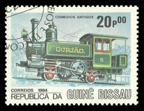 Locomotive Gurjao. Guinea Bissau - CIRCA 1984: Stamp printed by Guinea Bissau, Multicolor memorable edition offset printing on the topic of railway and steam Stock Images