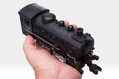 Locomotive on hand. In white royalty free stock photography