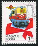 Locomotive. HUNGARY - CIRCA 1978: stamp printed by Hungary, shows Diesel Train, Pioneer's Kerchief, circa 1978 royalty free stock photography