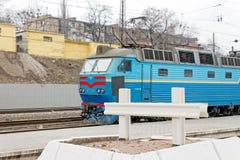 Locomotive at the Kharkiv Passenger Railway Station. Kharkiv, Ukraine - March 25, 2012: Locomotive at the Kharkiv Passenger Railway Station. Passenger train Royalty Free Stock Photos