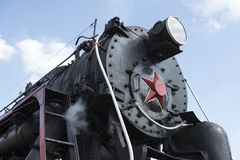 The locomotive of the last century standing under steam Royalty Free Stock Photo