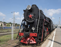 The locomotive of the last century standing under steam Royalty Free Stock Image