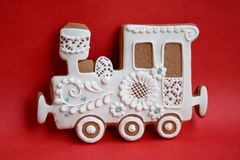 Locomotive made of gingerbread with icing on a colored background royalty free illustration