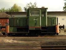 The locomotive, a monument, a train, a metal, green. Locomotive, metal, monument, old, rail, railway, retro, station, train, transport, transportation, travel Stock Photos