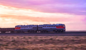 Locomotive moves by rail Stock Image