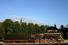 Locomotive old with the hook-on car Royalty Free Stock Images