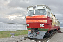 Locomotive. Of passenger train is on a background of the cloudy sky royalty free stock image