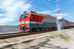 Locomotive of the passenger train is moving. Motion blur. RUSSIA, KRASNODAR KRAI, GIZELE-DERE VILLAGE, August 10, 2018: Locomotive of the passenger train is stock photo