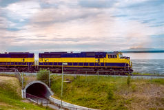 Locomotive powering on the seafront in Alaska Stock Images