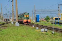 Locomotive at the railway station Stock Images