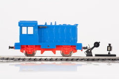 Locomotive and railway switch. Pictured items of a toy railroad Royalty Free Stock Photo