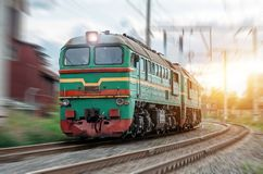 Locomotive rides at speed at the turn of the railway. Locomotive rides at speed at the turn of the railway Royalty Free Stock Photo