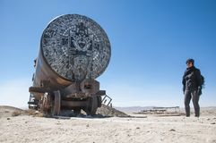 A locomotive in the salt. Winter in the train cemetery in the city of Uyuni in Bolivia, where several abandoned American and English locomotives and wagons are Royalty Free Stock Photography