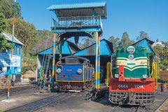 Locomotive shed on an Indian railway line. Coonoor, India - March 5, 2018: Engines employed on the UNESCO World Heritage Nilgiri Mountain railway being royalty free stock photos